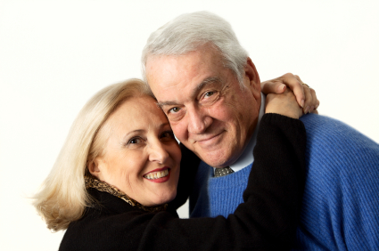 happy couple retiring on lots of income investments