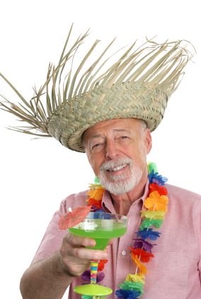 income investing retiree enjoying tropical drink on vacation cruise